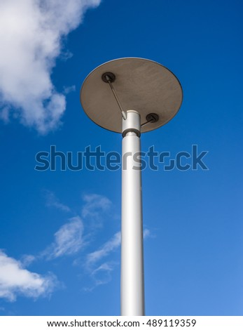 Modern halogen streetlight on a blue background.
