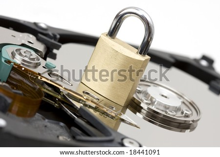 Modern Hard Disk with a Lock - a symbol for data security - stock photo