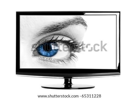 Modern HD TV showing a beautiful female blue eye. - stock photo