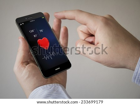 modern health concept: Close up of a man using smartphone - stock photo