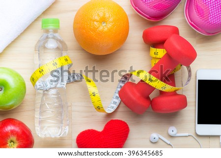 Modern healthy lifestyle fitness diet concept with objects on wooden table. View from above with copy space