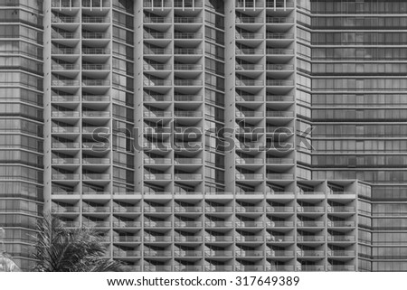 Modern high rise building architecture in tones of black, white, and gray/grey, for use as advertising background/message, or as wallpaper. - stock photo