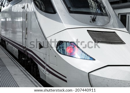 modern high-speed train at the railway station - stock photo