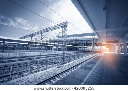 Modern high speed train at the railway station with motion blur effect - stock photo