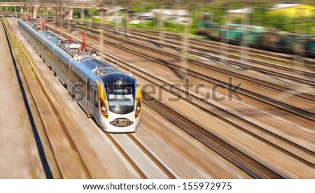 Modern high speed train on a clear day with motion blur - stock photo