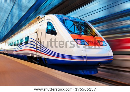 Modern high speed train with motion blur effect - stock photo