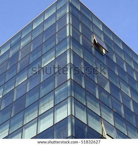 Modern highrise skyscraper steel and glass architecture - stock photo