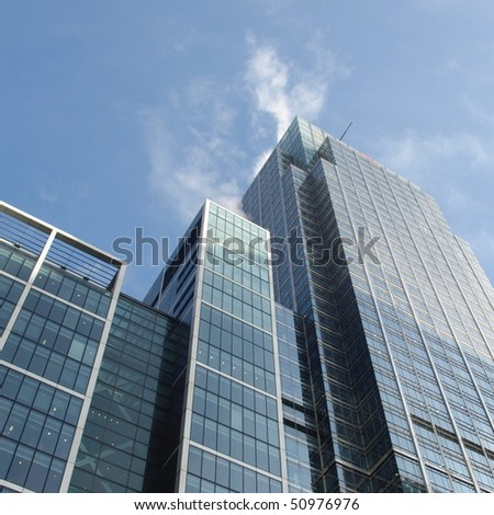 Modern highrise steel and glass architecture in the business district of Canary Wharf, London Docklands, UK - stock photo