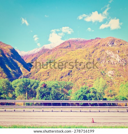 Modern Highway in Piedmont on the Background of Snow-capped Alps, Italy, Instagram Effect - stock photo