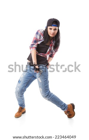 Modern hip-hop dance girl pose on isolated background. Break dance go-go girl standing on white