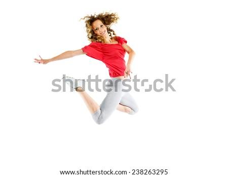 Modern hip-hop style teenage girl jumping - stock photo
