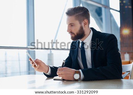 Modern hipster businessman using mobile phone - stock photo
