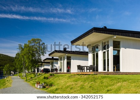Modern holiday home near Hardangerfjord in the Western part of Norway on a summer day.