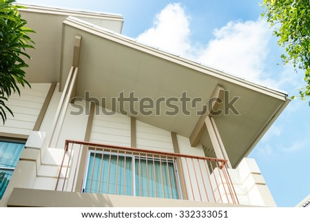 modern home blue sky background - stock photo