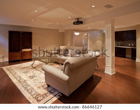 Modern home entertainment room in the basement - stock photo
