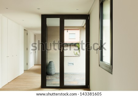 modern home interior, balcony view from the passage - stock photo