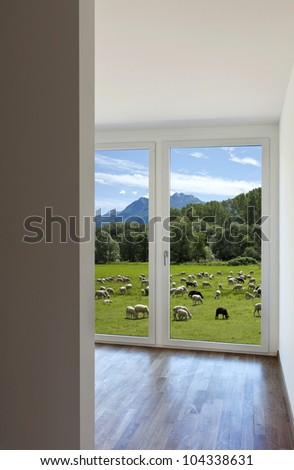 modern home interior, window with countryside views - stock photo