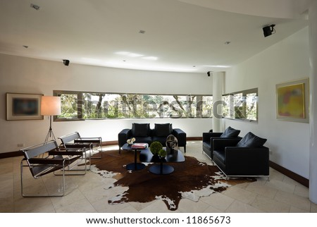 Modern home interior with designer furniture. -Original artwork blurred out- - stock photo