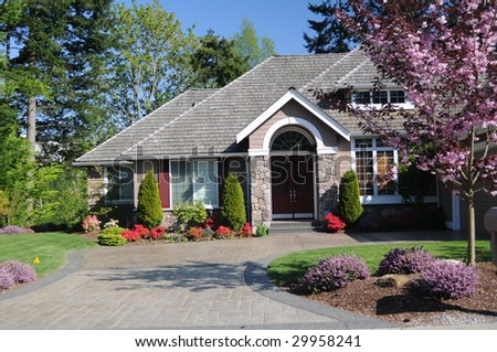 Modern Home with Cherry Blossoms in the yard - stock photo