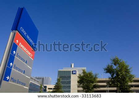 Modern hospital and sign