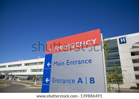 Modern hospital and sign with clear blue sky taken in Brampton Ontario Canada - stock photo