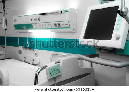 Modern hospital bed with computer and monitor