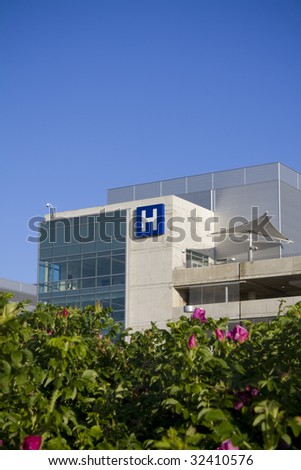 Modern hospital with flowers in foreground - stock photo