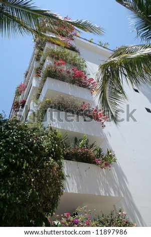Modern hotel in Puerto Vallarta Mexico with lots of flowers - stock photo