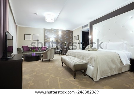 Modern hotel room interior in the evening