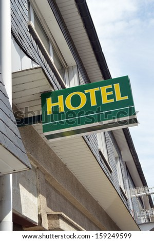 Modern Hotel sign at the facade of a building - stock photo