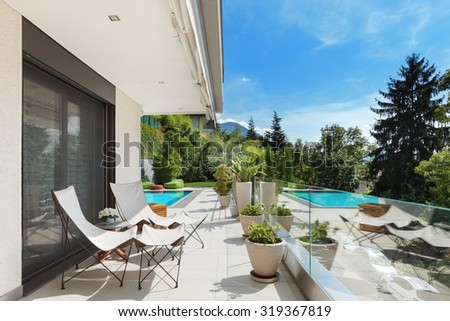 Modern house, beautiful terrace with swimming pool - stock photo