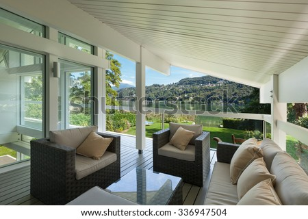 modern house beautiful veranda furniture stock photo edit now 336947504 shutterstock. Black Bedroom Furniture Sets. Home Design Ideas