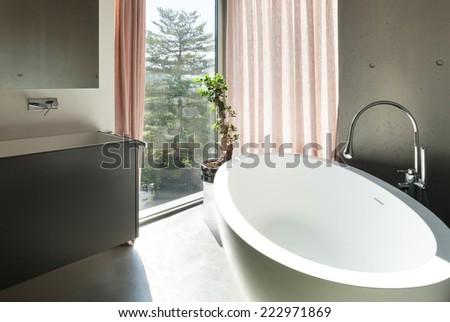 Modern house, detail bathroom, ceramic bathtub - stock photo