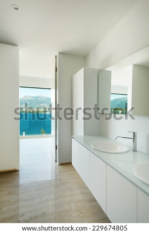 Modern house, detail bathroom, sink and mirror - stock photo