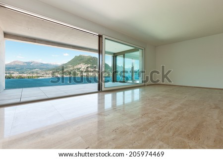 modern house, empty room with window overlooking the lake - stock photo