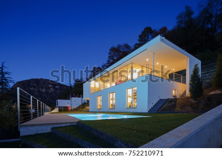 modern house lights. Modern house  exterior in the night lights on House Exterior Night Lights On Stock Photo 752210971
