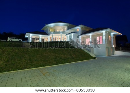 Modern house exterior, large and expensive house architecture. - stock photo