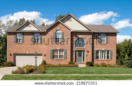 Modern House in Fall - stock photo