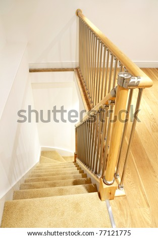 Modern House Interior -  Typical UK British Stairs with Chrome Railing with Beige Carpet. Looking down - stock photo