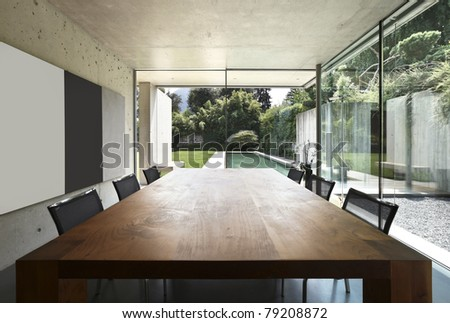 modern house interior, wooden dining table - stock photo
