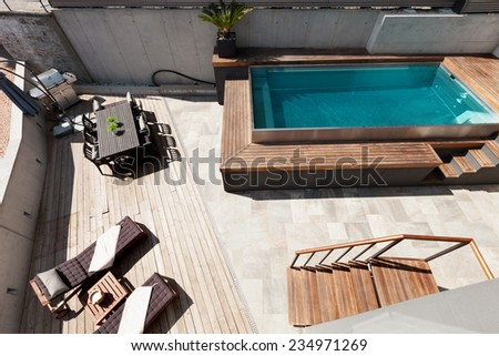 Modern house, swimming pool view, outdoor - stock photo