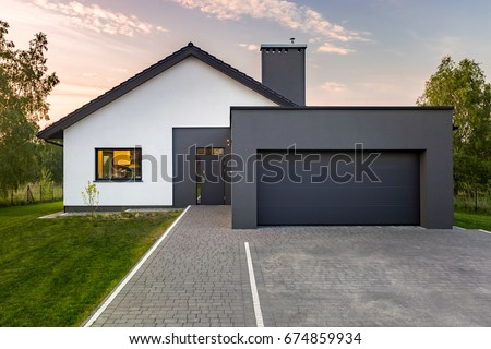 Modern House With Garage And Green Lawn Exterior View