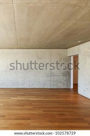 modern house with hardwood floor, concrete walls
