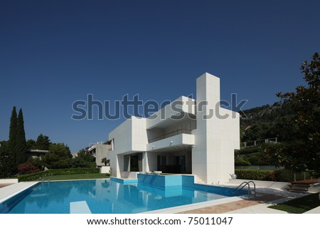modern house with pool - stock photo