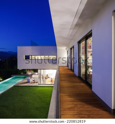 Modern house with pool and garden, summer time - stock photo