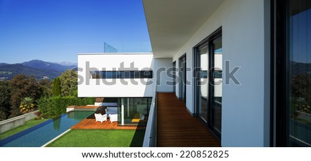 Modern house with pool and garden, summer time