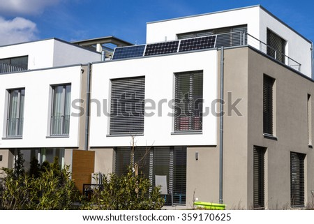 Modern house with solar panel - stock photo