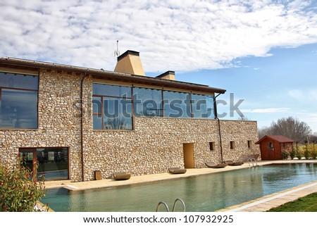 Modern house with windows and large pool - stock photo