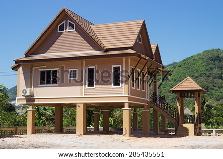 Modern houses on piles in Thailand - stock photo