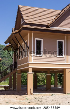 Modern houses on piles in Thailand, fragment - stock photo